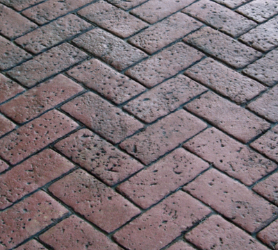 Zigzag patterned brick paver designed stamped concrete.