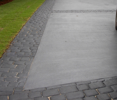 Plain concrete driveway with stamped borders.