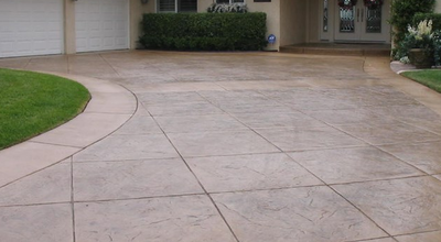 Brown stamped concrete driveway with straight square concrete cuts.