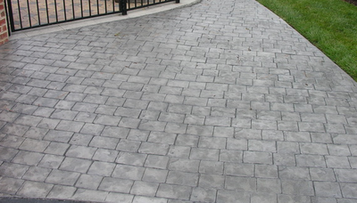 Charcoal gray stamped concrete driveway