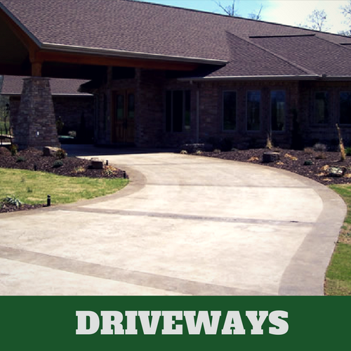 Two toned colored concrete driveway in Brentwood, TN with brick home.