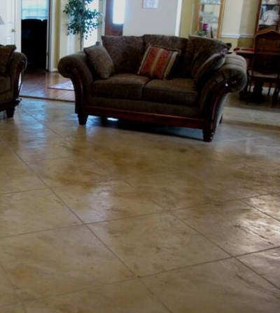 Family room interior concrete floor stamped and polished.