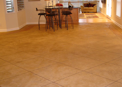 Stamped interior floor concrete cut into squares made to look like tile.
