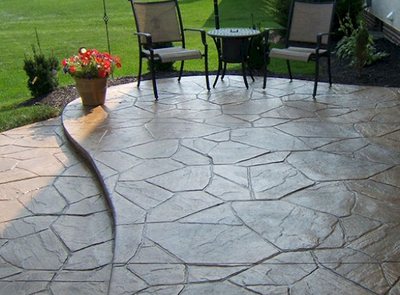 Stamped stone style concrete patio with two levels.