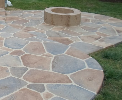 Sand stone slate stamped concrete patio with built in fire pit.