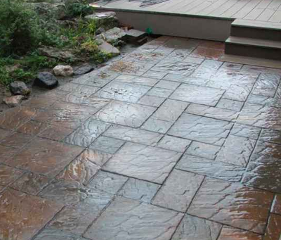 Outdoor patio stamped with a brick paver design.