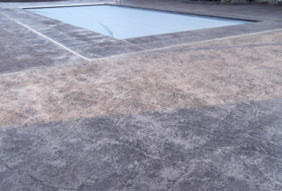 Gray pool deck textured concrete.