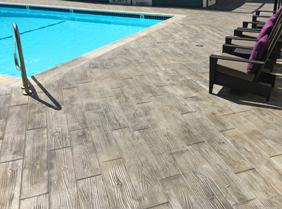 Wood plank design stamp pool deck.