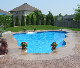 Pool deck edged in plain concrete and stamped concrete around that.