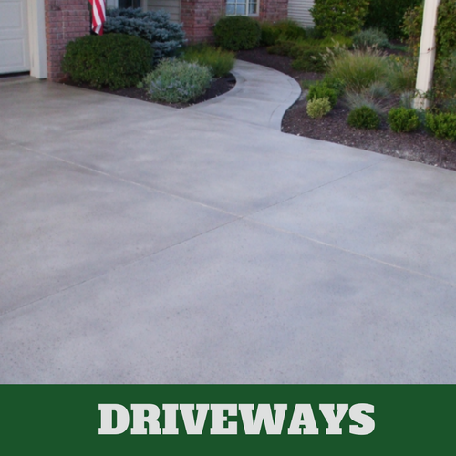 Concrete driveway with a dark gray color additive and concrete sealer.