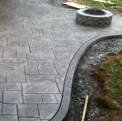Stamped concrete patio with built in fire pit