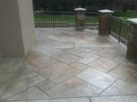 Wrap around front porch with tile stamped concrete.