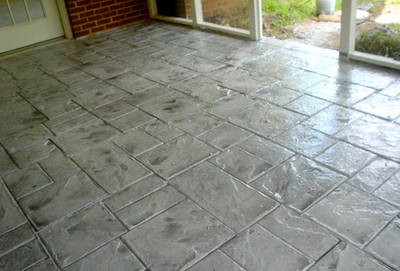 Stamped gray inside patio made to look like stone blocks.