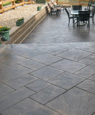 Stamped concrete squares for a porch, steps and patio.