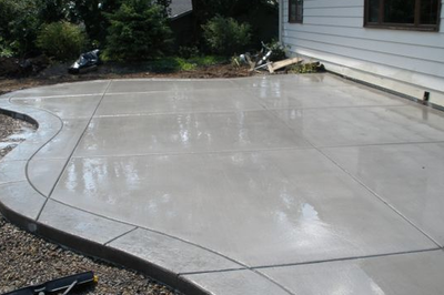 Stamped concrete border around polished concrete patio.